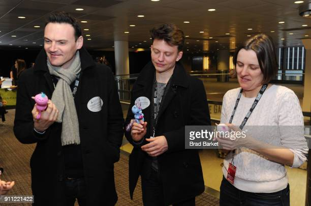 Singers James Arthur Helen Ashby and Ben Hymas attends the GRAMMY Gift Lounge during the 60th Annual GRAMMY Awards at Madison Square Garden on...