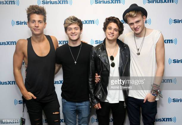 Singers James McVey Connor Ball Brad Simpson and Tristan Evans of The Vamps visit SiriusXM Hits1 at the SiriusXM Studios on August 20 2014 in New...