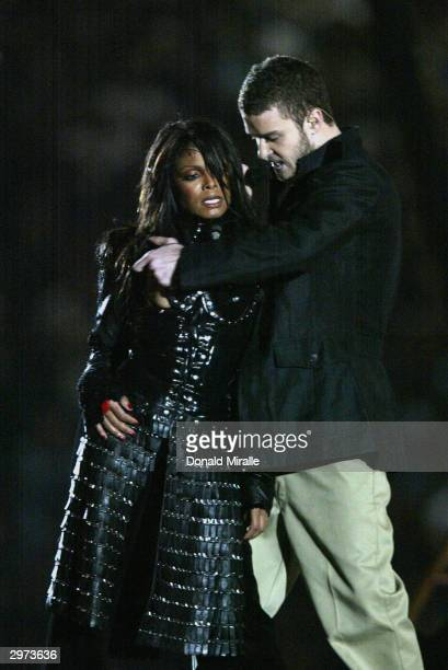 Singers Janet Jackson and Justin Timberlake perform during the halftime show at Super Bowl XXXVIII between the New England Patriots and the Carolina...