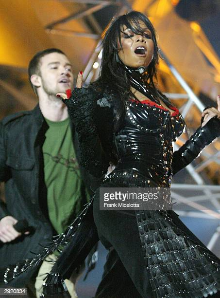 Singers Janet Jackson and surprise guest Justin Timberlake perform during the halftime show at Super Bowl XXXVIII between the New England Patriots...