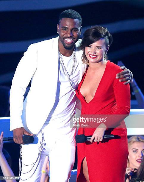 Singers Jason Derulo and Demi Lovato speak onstage during the 2014 MTV Video Music Awards at The Forum on August 24 2014 in Inglewood California