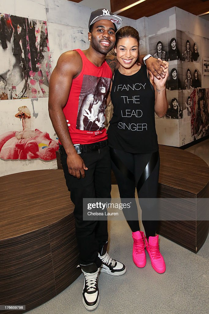 Singers Jason Derulo (L) and Jordin Sparks pose backstage before Jason Derulo's summer sessions performance at Warner Bros. Records Boutique Store on August 16, 2013 in Burbank, California.