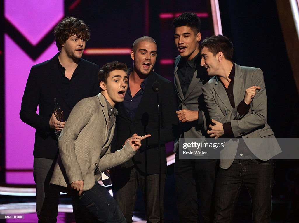 Singers Jay McGuiness, Nathan Sykes, Max George, Siva Kaneswaran, and Tom Parker of The Wanted accept the Favorite Breakout Artist award onstage at the 39th Annual People's Choice Awards at Nokia Theatre L.A. Live on January 9, 2013 in Los Angeles, California.