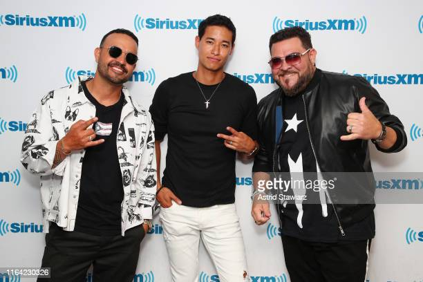 Singers Jay Rodriguez Tony Succar and Angel Lopez pose for photos after a performance for SiriusXM's Caliente Channel at the SiriusXM studios in New...