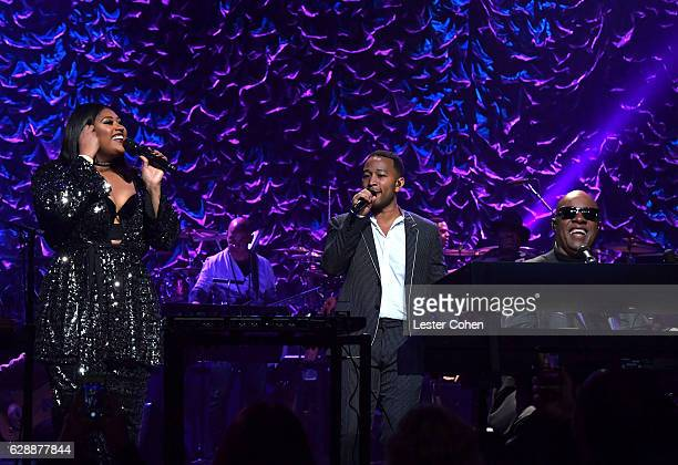 Singers Jazmine Sullivan John Legend and Stevie Wonder perform at Stevie's 20th Annual House Full of Toys Benefit Concert at Microsoft Theater on...