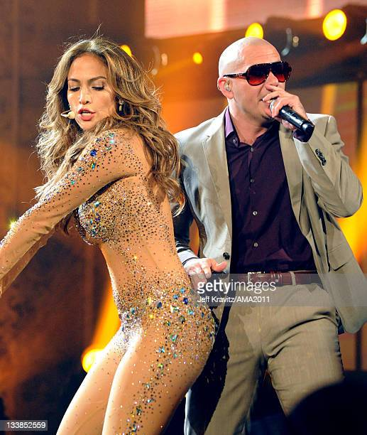 Singers Jennfier Lopez and Pitbull onstage at the 2011 American Music Awards held at Nokia Theatre LA LIVE on November 20 2011 in Los Angeles...
