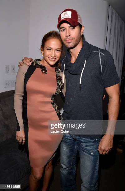 Singers Jennifer Lopez and Enrique Iglesias pose backstage at a press conference at Boulevard3 on April 30 2012 in Hollywood California