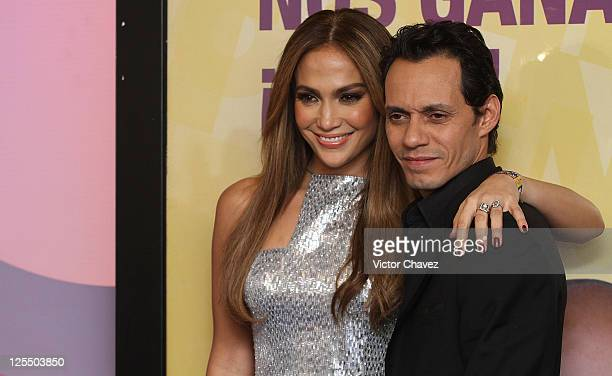 Singers Jennifer Lopez and her husband Marc Anthony attend a press conference during the Teleton 2010 tv broadcast at Televisa San Angel on December...