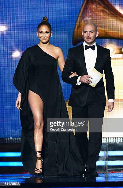 Singers Jennifer Lopez and Pitbull speak onstage at the 55th Annual GRAMMY Awards at Staples Center on February 10 2013 in Los Angeles California