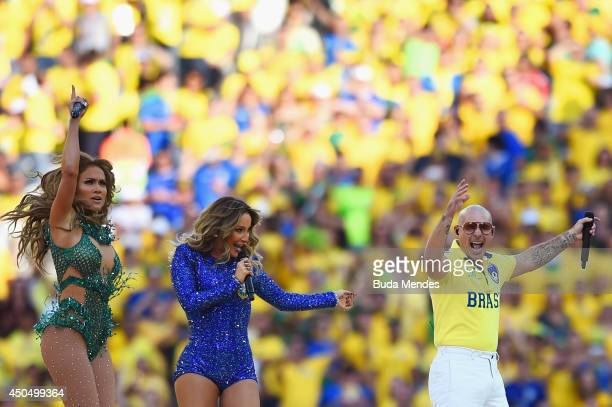 Singers Jennifer Lopez, Claudia Leitte and Pitbull perform during the Opening Ceremony of the 2014 FIFA World Cup Brazil prior to the Group A match...