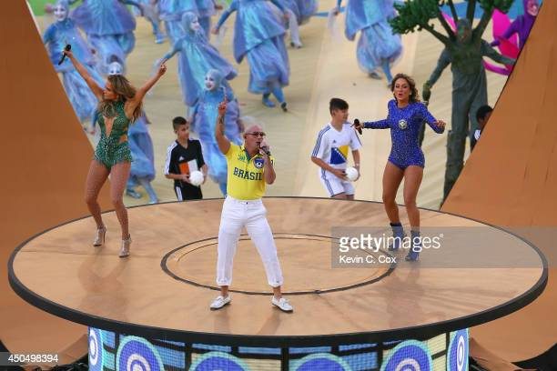 Singers Jennifer Lopez Pitbull and Claudia Leitte perform during the Opening Ceremony of the 2014 FIFA World Cup Brazil prior to the Group A match...