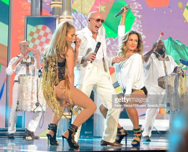 Singers Jennifer Lopez Pitbull and Claudia Leitte perform onstage during the 2014 Billboard Music Awards at the MGM Grand Garden Arena on May 18 2014...