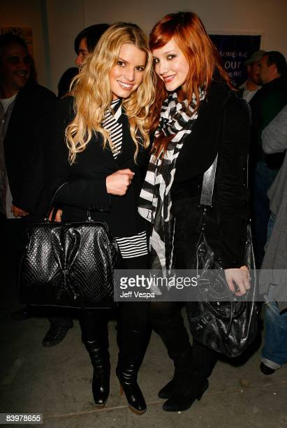 WEST HOLLYWOOD CA DECEMBER 09 Singers Jessica Simpson and Ashlee Simpson attend the gallery opening of Without You I'm Just Me held at Gallery 1988...