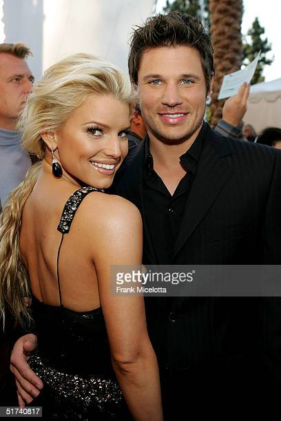 Singers Jessica Simpson and husband Nick Lachey arrive to the 32nd Annual American Music Awards on November 14 2004 at the Shrine Auditorium in Los...