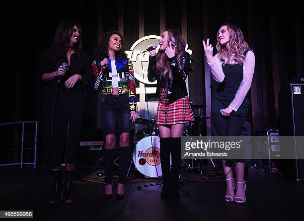 Singers Jesy Nelson LeighAnne Pinnock Jade Thirlwall and Perrie Edwards of the girl band Little Mix perform onstage at the Hard Rock Cafe Hollywood...