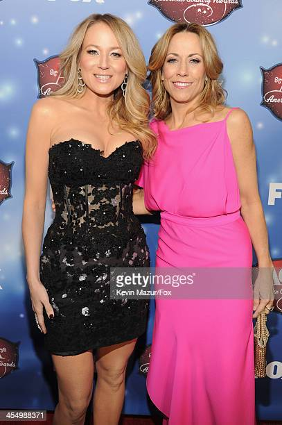 Singers Jewel and Sheryl Crow arrive at the American Country Awards 2013 at the Mandalay Bay Events Center on December 10, 2013 in Las Vegas, Nevada.