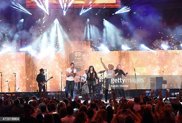Singers Jimi Westbrook Karen Fairchild Kimberly Schlapman and Philip Sweet of Little Big Town perform onstage during the 2015 iHeartRadio Country...
