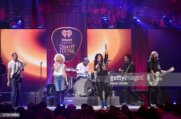 Singers Jimi Westbrook Kimberly Schlapman Karen Fairchild and Philip Sweet of Little Big Town perform onstage during the 2015 iHeartRadio Country...