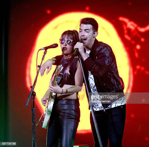 Singers JinJoo Lee and Joe Jonas of band DNCE perform onstage at the Prudential Center on June 2 2016 in Newark New Jersey