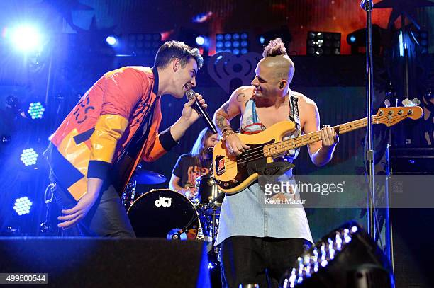 Singers Joe Jonas and Cole Whittle of DNCE perform onstage during 106.1 KISS FM's Jingle Ball 2015 presented by Capital One at American Airlines...