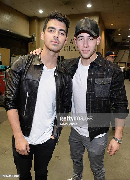 Singers Joe Jonas and Nick Jonas attends the 2015 iHeartRadio Music Festival at MGM Grand Garden Arena on September 18 2015 in Las Vegas Nevada