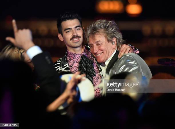 Singers Joe Jonas of DNCE and Sir Rod Stewart perform during a pretaping for the 2017 MTV Video Music Awards at the Palms Casino Resort on August 24...