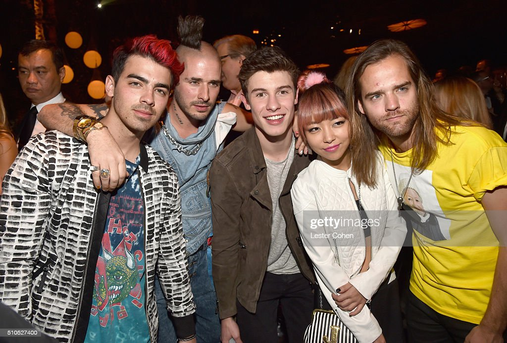 Singers Joe Jonas (L), Shawn Mendes (C) and DNCE attend Universal Music Group 2016 Grammy After Party presented by American Airlines and Citi at The Theatre at Ace Hotel Downtown LA on February 15, 2016 in Los Angeles, California.