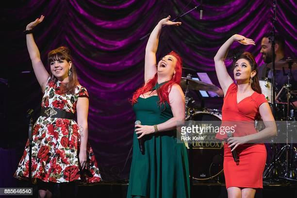 Singers Joey Cook Dani Armstrong and Robyn Adele Anderson of Scott Bradlee's Postmodern Jukebox perform in concert at ACL Live on December 3 2017 in...