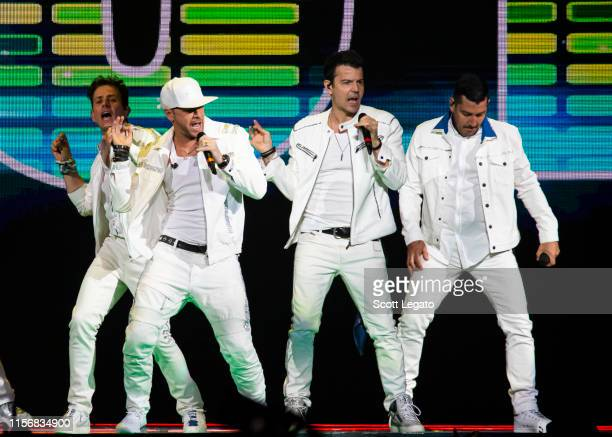 Singers Joey McIntyre Donnie Wahlberg Jordan Knight and Jonathan Knight of New Kids on the Block perform during a stop of the Mixtape Tour at Little...