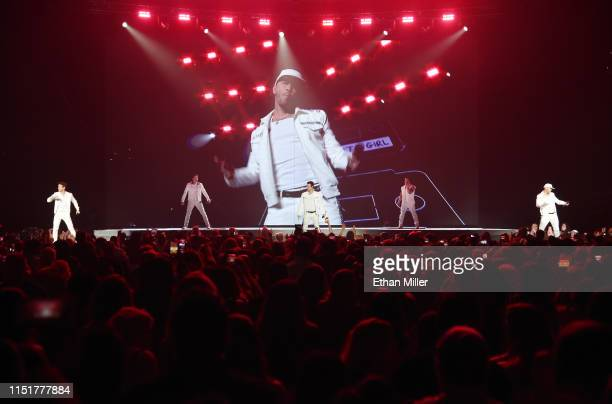 Singers Joey McIntyre Jonathan Knight Jordan Knight Danny Wood and Donnie Wahlberg3 of New Kids on the Block perform during a stop of the Mixtape...