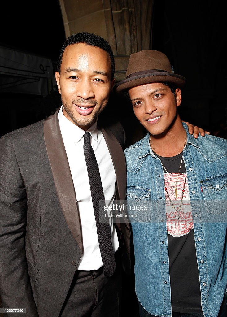 Singers John Legend (L) and Bruno Mars attend the Warner Music Group Grammy Celebration hosted by InStyle at Chateau Marmont on February 12, 2012 in Los Angeles, California.