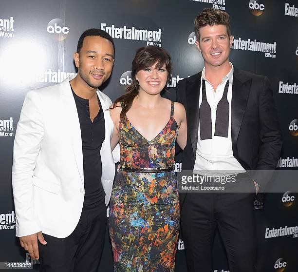 Singers John Legend Kelly Clarkson and Robin Thicke attend the Entertainment Weekly ABCTV Up Front VIP Party at Dream Downtown on May 15 2012 in New...
