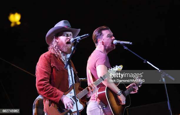 Singers John Osborne and TJ Osborne of Brothers Osborne perform onstage at the Bash at the Beach presented by WME at the Mandalay Bay Beach at...