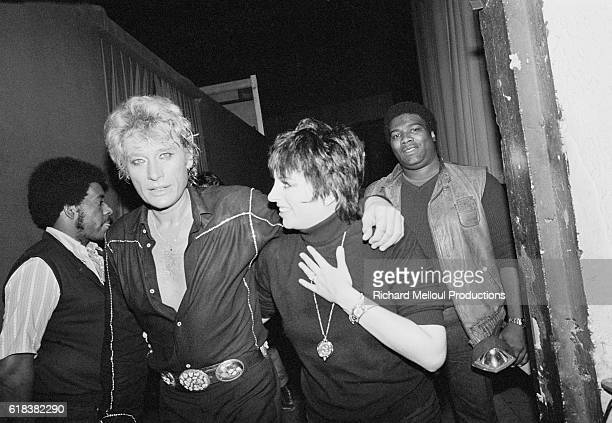 Singers Johnny Hallyday and Liza Minnelli hug backstage after a performance during which they sang together Hallyday is one of the most popular...