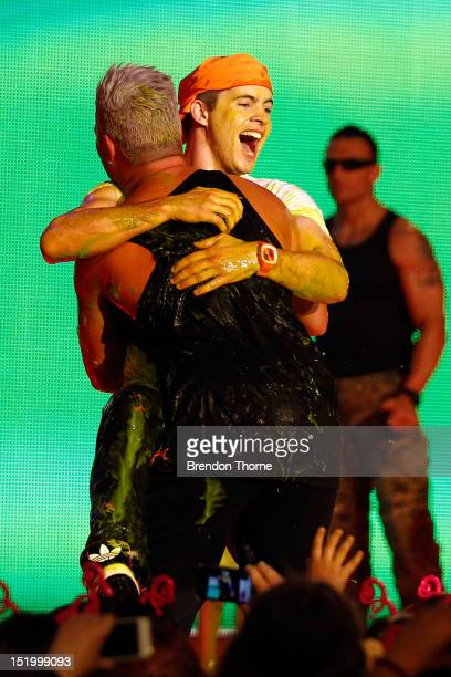 Singers Johnny Ruffo and Stan Walker embrace after getting slimed during the matinee Nickelodeon Slimefest 2012 show at Hordern Pavilion on September...