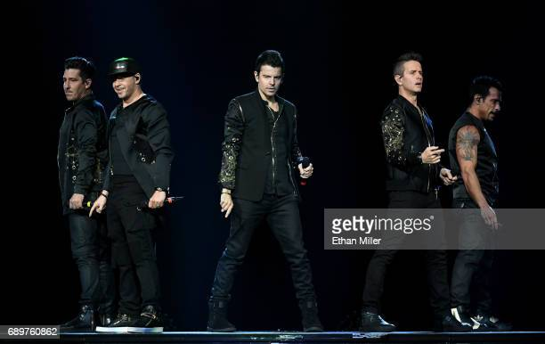 Singers Jonathan Knight Donnie Wahlberg Jordan Knight Joey McIntyre and Danny Wood of New Kids on the Block perform during a stop of The Total...