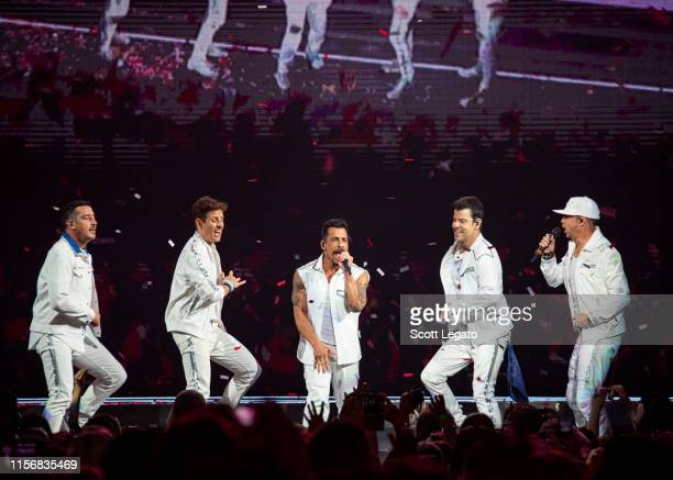 Singers Jonathan Knight Joey McIntyre Danny Wood Joey McIntyre Jordan Knight and Donnie Wahlberg of New Kids on the Block perform during a stop of...