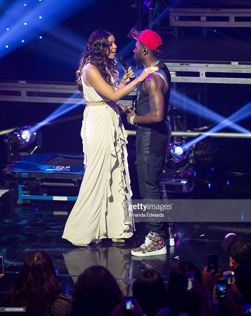 Singers Jordin Sparks (L) and Jason Derulo perform onstage at the Clear Channel iHeartRadio album release party for Jason Derulo's new album 'Talk Dirty' at the iHeartRadio Theater on April 15, 2014 in Burbank, California.