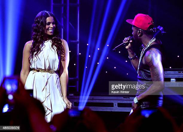 Singers Jordin Sparks and Jason Derulo perform onstage during Clear Channel's presentation of an exclusive performance and album release party with...