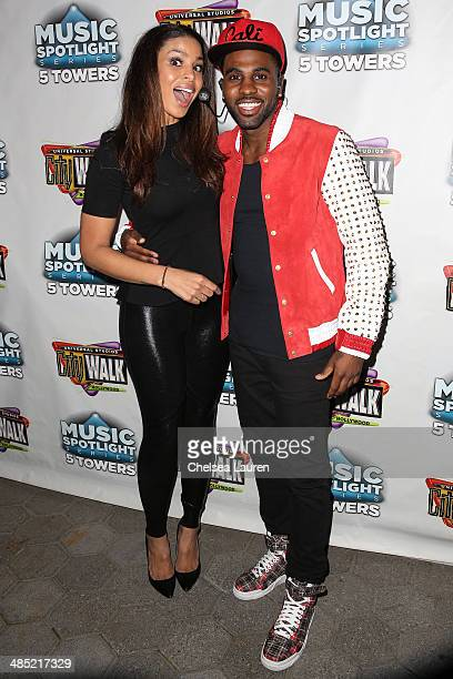 Singers Jordin Sparks and Jason Derulo pose backstage at 5 Towers Outdoor Concert Arena on April 16 2014 in Universal City California