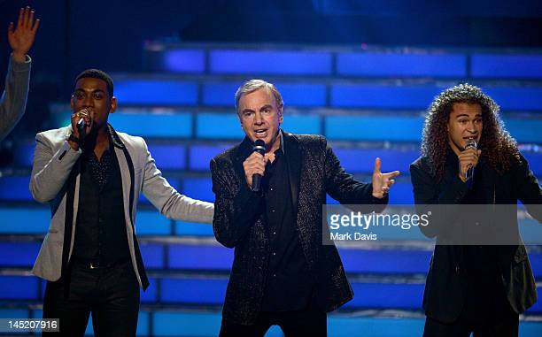 Singers Joshua Ledet Neil Diamond and DeAndre Brackensick perform onstage during Fox's American Idol 2012 results show at Nokia Theatre LA Live on...