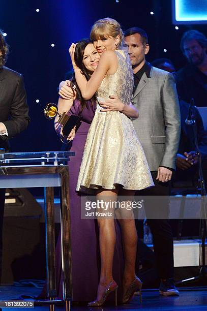 Singers Joy Williams of the Civil Wars and Taylor Swift accept an award onstage during the 55th Annual GRAMMY Awards at Nokia Theatre LA Live on...