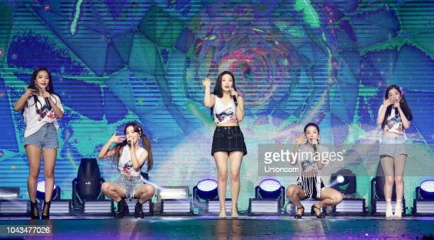 Singers Joy Yeri Irene Seulgi and Wendy of South Korean girl group Red Velvet perform onstage during a concert at the National Taiwan University...