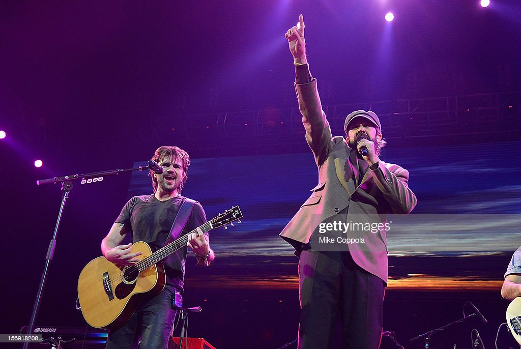 Singers Juanes and Juan Luis Guerra perform at Barclays Center of Brooklyn on November 24, 2012 in New York City.