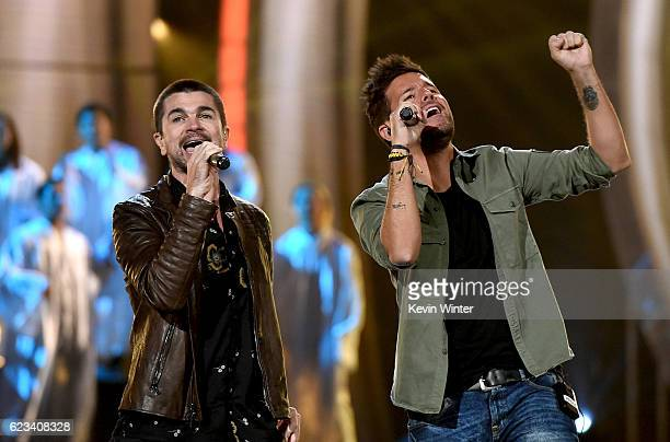 Singers Juanes and Pablo Lopez perform onstage during rehearsals for the 17th annual Latin Grammy Awards at TMobile Arena on November 15 2016 in Las...