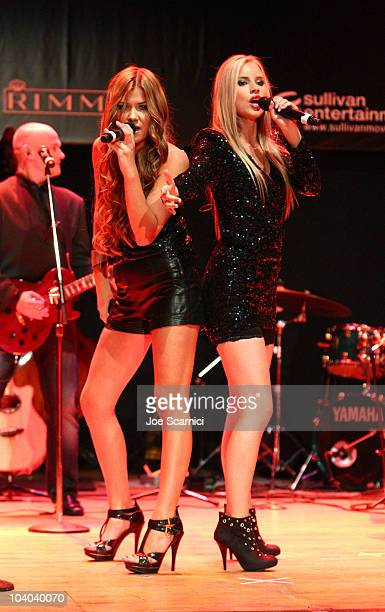 Singers Julia Williamson and Clara Hagman of the band Ace of Base perform at the amfAR Cinema Against AIDS held at The Carlu during the Toronto...
