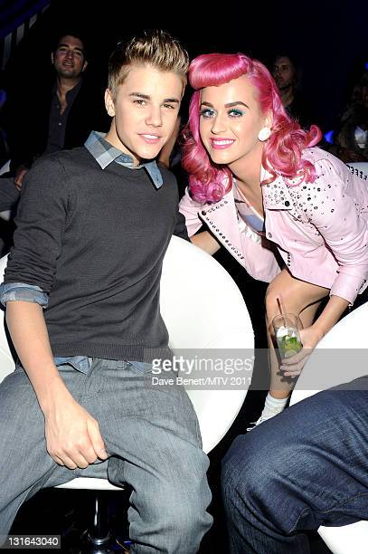 Singers Justin Bieber and Katy Perry pose in the VIP Glamour area during the MTV Europe Music Awards 2011 at Odyssey Arena on November 6 2011 in...