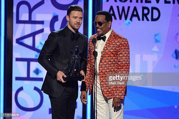 Singers Justin Timberlake and Charlie Wilson perform onstage during the 2013 BET Awards at Nokia Theatre LA Live on June 30 2013 in Los Angeles...