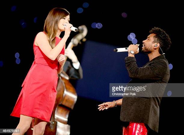 Singers Kacey Musgraves and Miguel perform onstage at 2014 MusiCares Person Of The Year Honoring Carole King at Los Angeles Convention Center on...