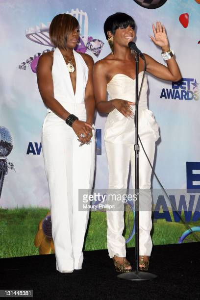 Singers Kalenna Harper and Dawn Richard of the group Diddy Dirty Money pose in the press room at the BET Awards '11 held at The Shrine Auditorium on...